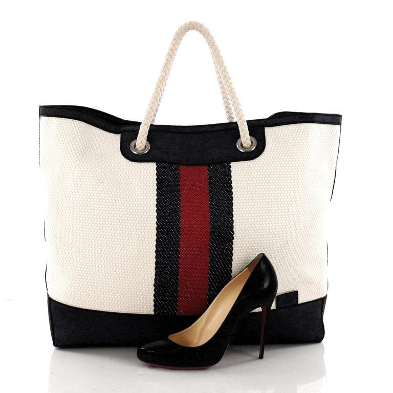 8c612aee5c2 This authentic Gucci Web Open Tote Canvas XL is your perfect everyday bag.  Crafted in