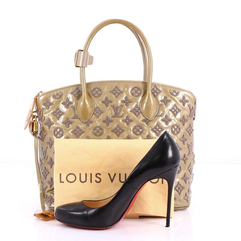 3ee535c4e5b8 Louis Vuitton Fascination Lockit Patent Lambskin Handbag at 1stdibs
