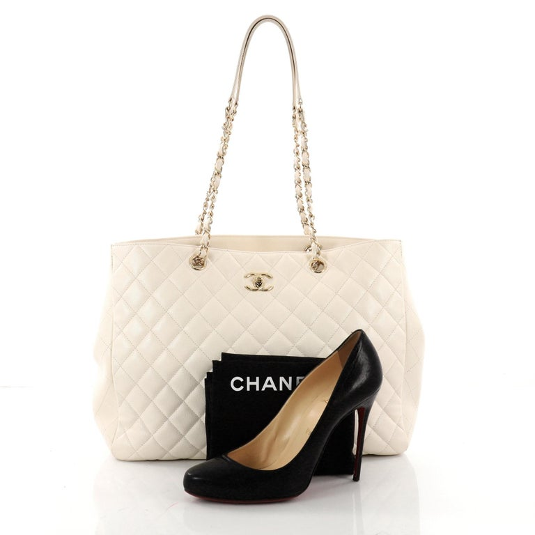 8468fedb15dff5 This authentic Chanel Classic CC Shopping Tote Quilted Caviar Large is the  perfect companion for the