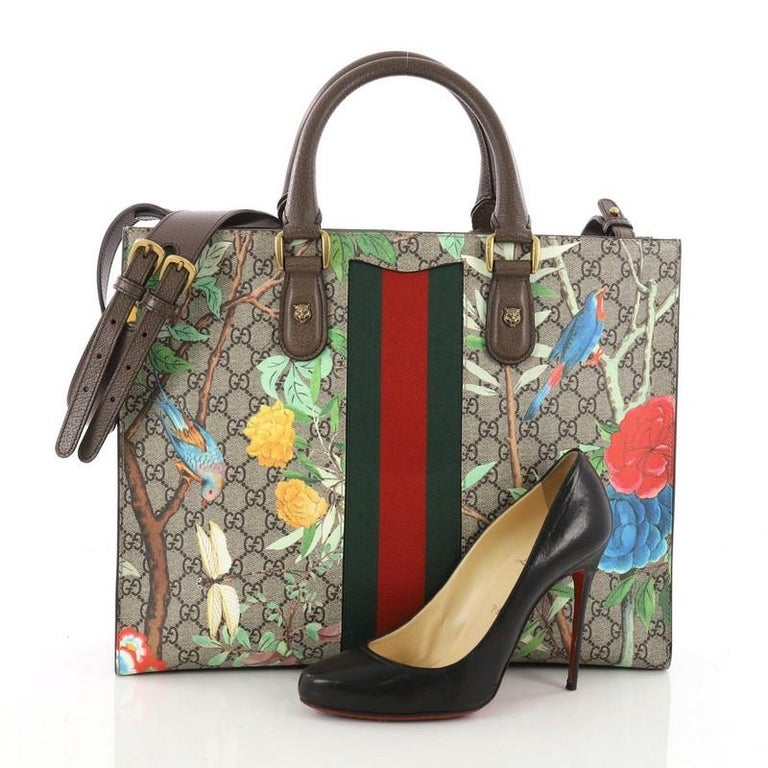 d3270ce7ab5b This authentic Gucci Animalier Web Top Handle Tote Tian Print GG Coated  Canvas Large balances understated