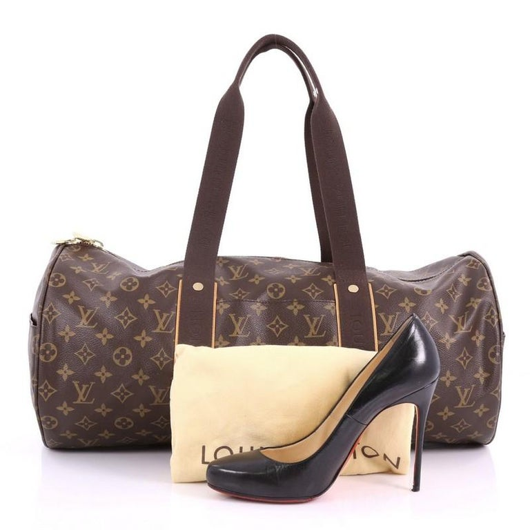 This authentic Louis Vuitton Beaubourg Sporty Duffle Bag Monogram Canvas is  perfect for a weekend travel