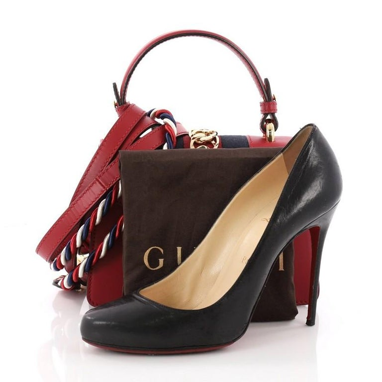ef1405eb166d40 This authentic Gucci Sylvie Top Handle Bag Leather Mini is a stylish bag  perfect for the