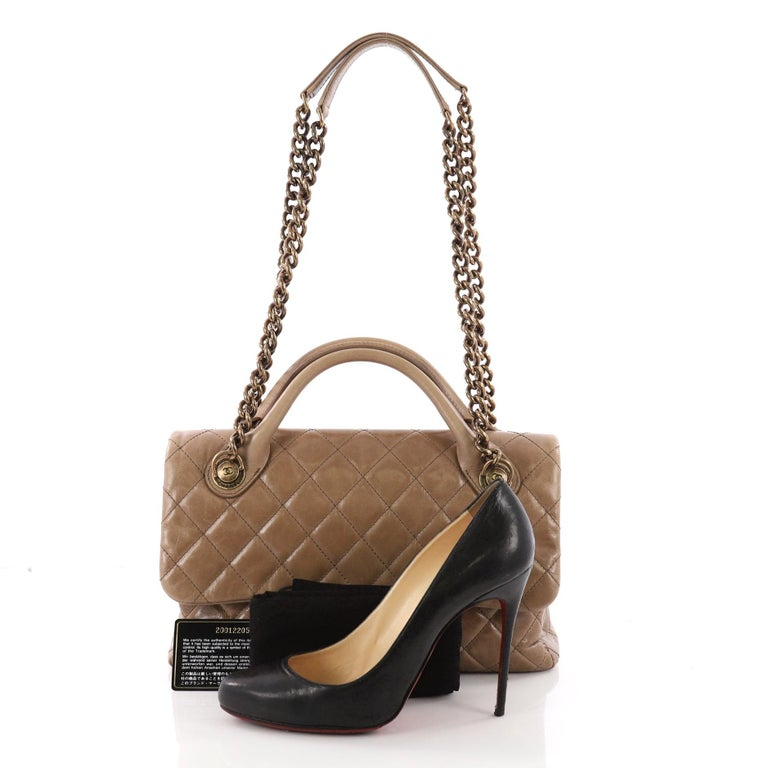 2c660b2ede07 This Chanel Castle Rock Flap Bag Quilted Glazed Calfskin Medium, crafted in  brown quilted glazed
