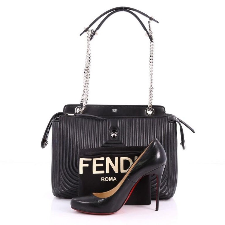 a29dffa28a This authentic Fendi DotCom Click Shoulder Bag Quilted Leather Medium is a  chic and minimalist bag