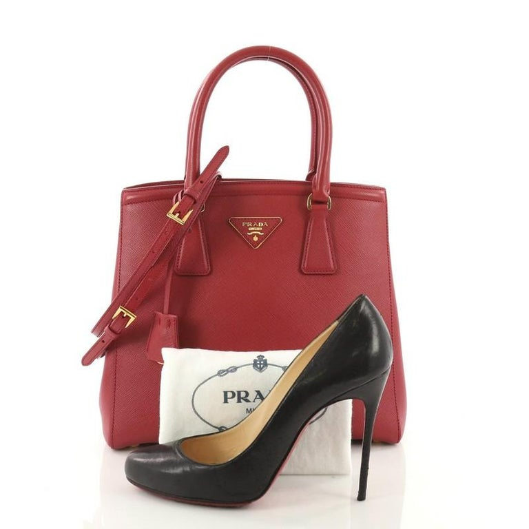 2c21d83b8728 This Prada Lux Convertible Open Tote Saffiano Leather Small, crafted from  red saffiano leather,