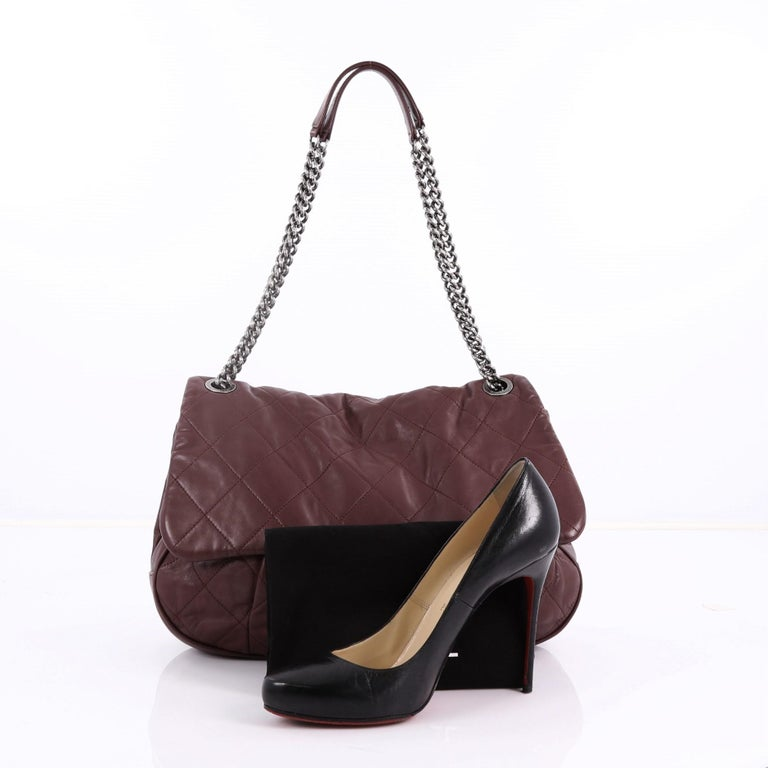 0d434c55259f91 This Chanel Coco Pleats Flap Bag Quilted Calfskin, crafted in burgundy quilted  calfskin leather,
