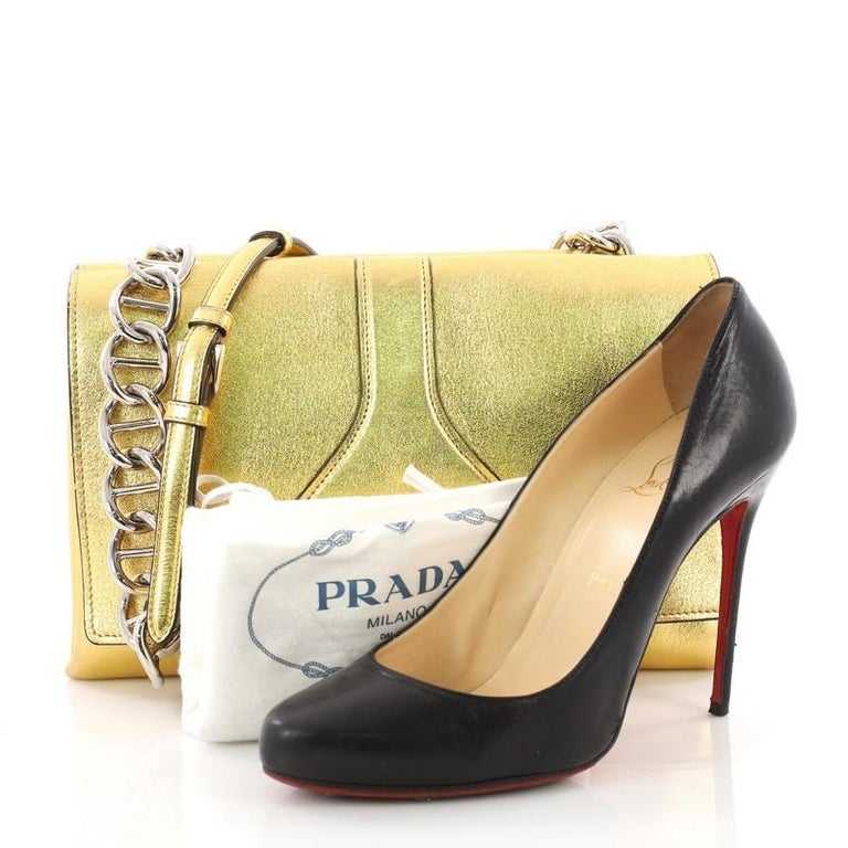 d1d1623b070b This Prada Turnlock Flap Chain Bag Leather Small, crafted in gold leather,  features a