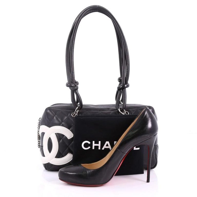 a0b5aef128 This Chanel Cambon Bowler Bag Quilted Leather Medium, crafted from black  diamond quilted leather,