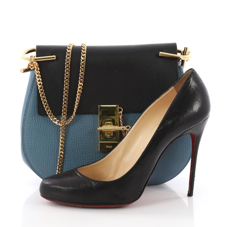 61e2110cd This Chloe Drew Crossbody Bag Leather Small, crafted in blue and black  leather, features
