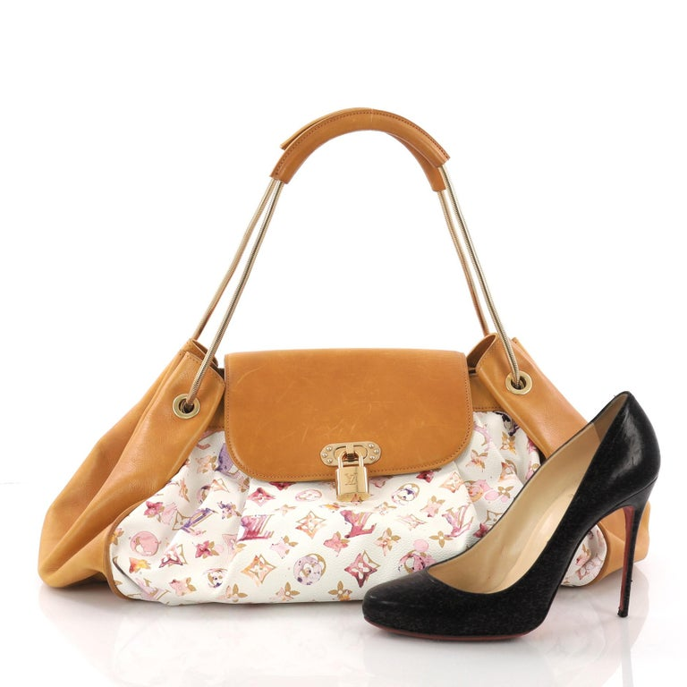 This Louis Vuitton Jamais Handbag Limited Edition Aquarelle Monogram Canvas, crafted in white aquarelle monogram coated canvas and brown leather, features dual mesh rope metal handles with leather shoulder pads and gold-tone hardware . Its mock lock