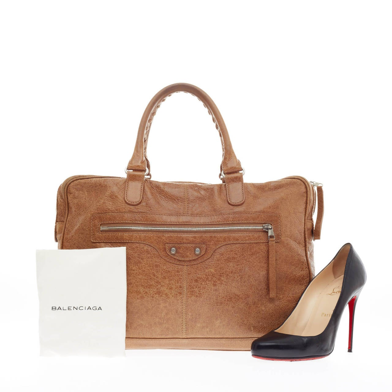 89675980eacb This authentic Balenciaga Mini Folder Leather in golden tan is for the  fashionable working professional.