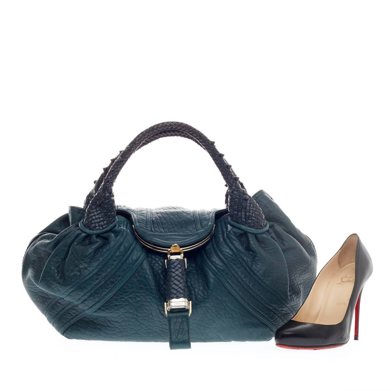 cd1557f8553 This authentic Fendi Spy Bag Leather showcases one of the brand s most  popular designs. Constructed