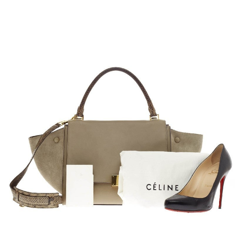 This authentic Celine Trapeze Suede Medium with genuine luxurious python accents is a fashionista's dream. Constructed in beautiful Souris gray leather and matching suede wings, this popular satchel features a full frontal flap with gold square