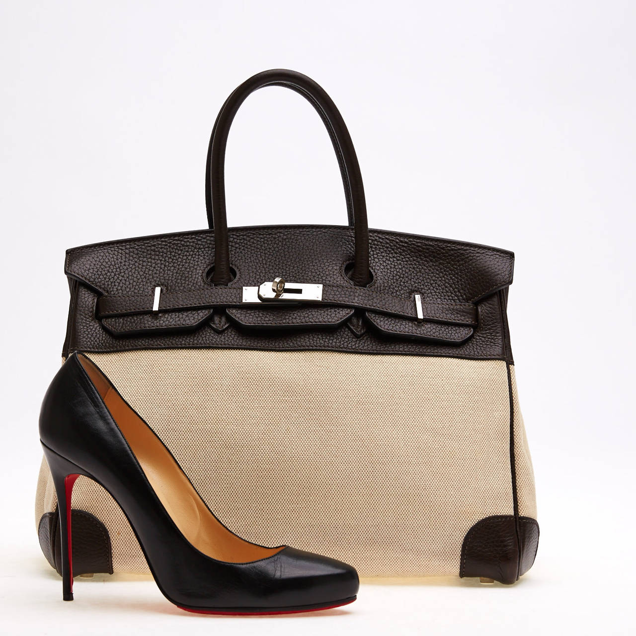 566b6d3698 This authentic Hermes Birkin Canvas and Leather 35 is quite distinct yet  understated. It is