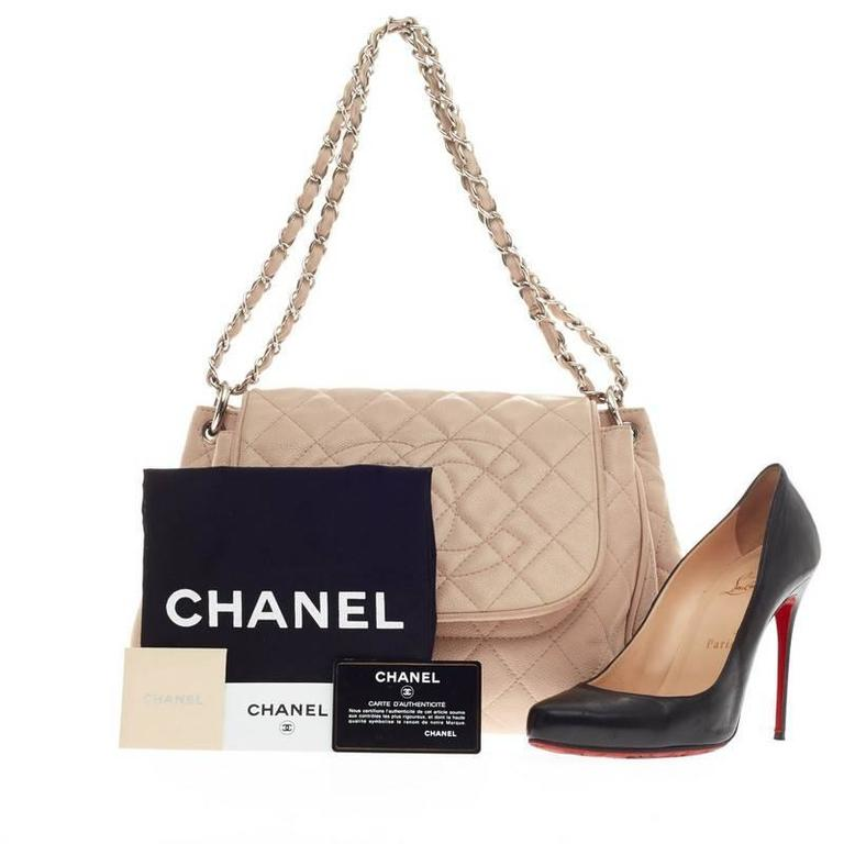 b6e1c33e7677 This authentic Chanel Timeless Accordion Flap Caviar is the perfect  polished bag for a day or
