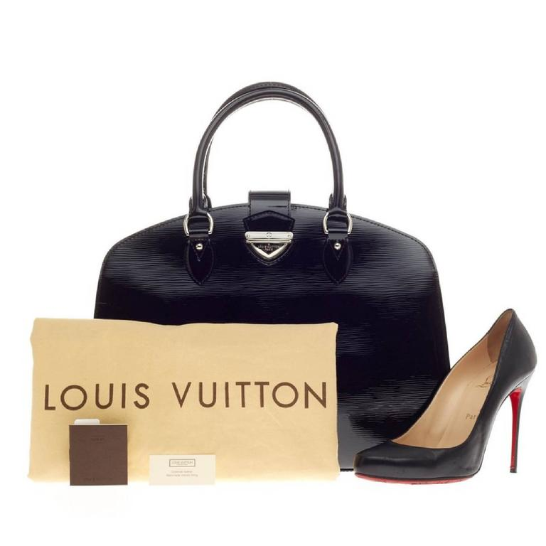 f1da1d254213 This authentic Louis Vuitton Pont Neuf Electric Epi Leather GM is a classic  must-have