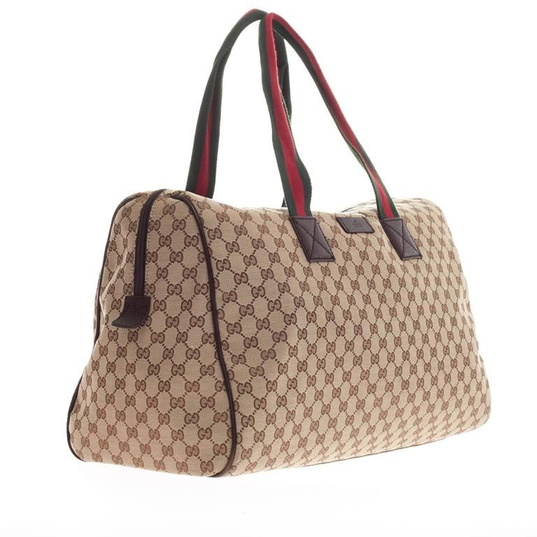 0186d53c2 This authentic Gucci Web Handle Overnight Duffle GG Canvas Medium is  perfect for light travel.