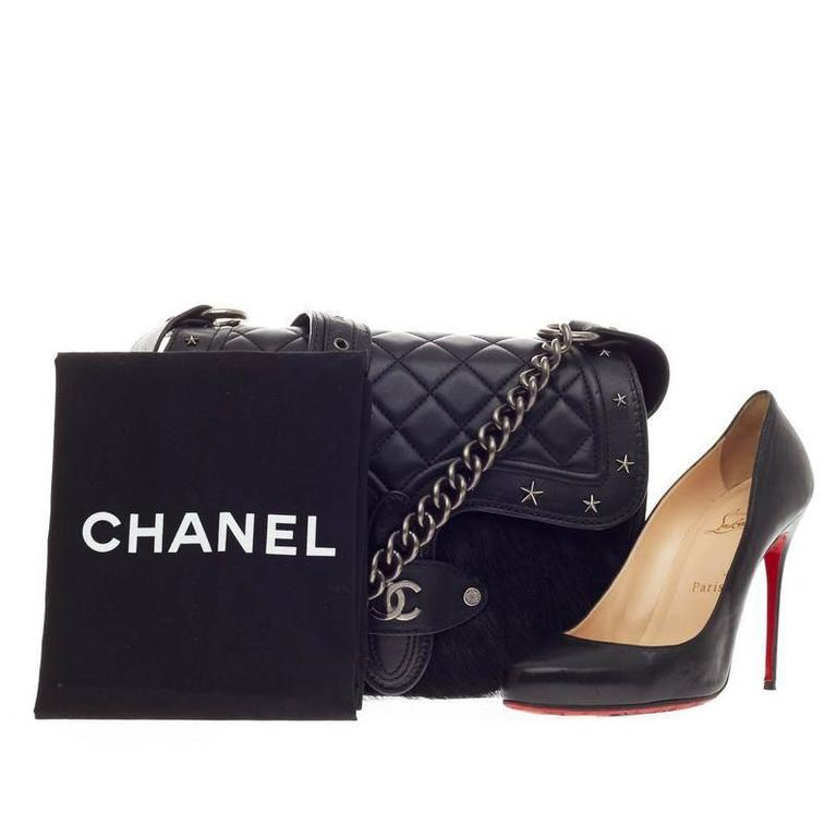 21503c40ddd9 This authentic limited edition Chanel Dallas Studded Saddle Bag Quilted  Calfskin and Pony Hair showcased in