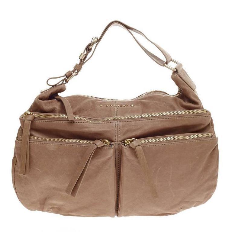 f9cf2bb128be Givenchy Zip Multi Pocket Hobo Leather Medium at 1stdibs