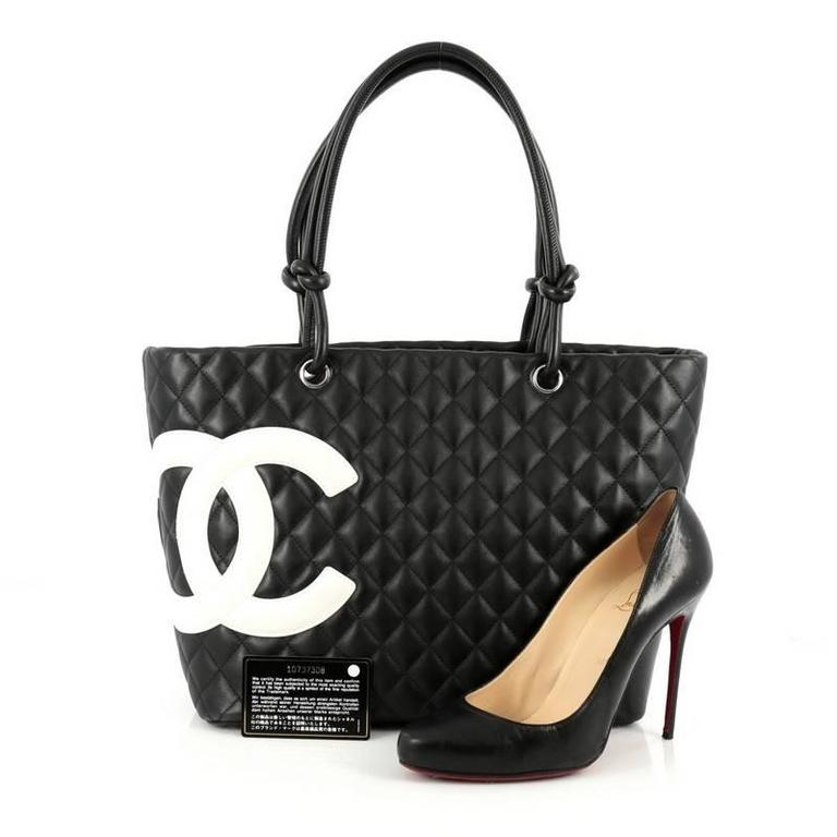 7c09fa6d7407 This authentic Chanel Cambon Tote Quilted Leather Large is a finely crafted  bag from the brand's