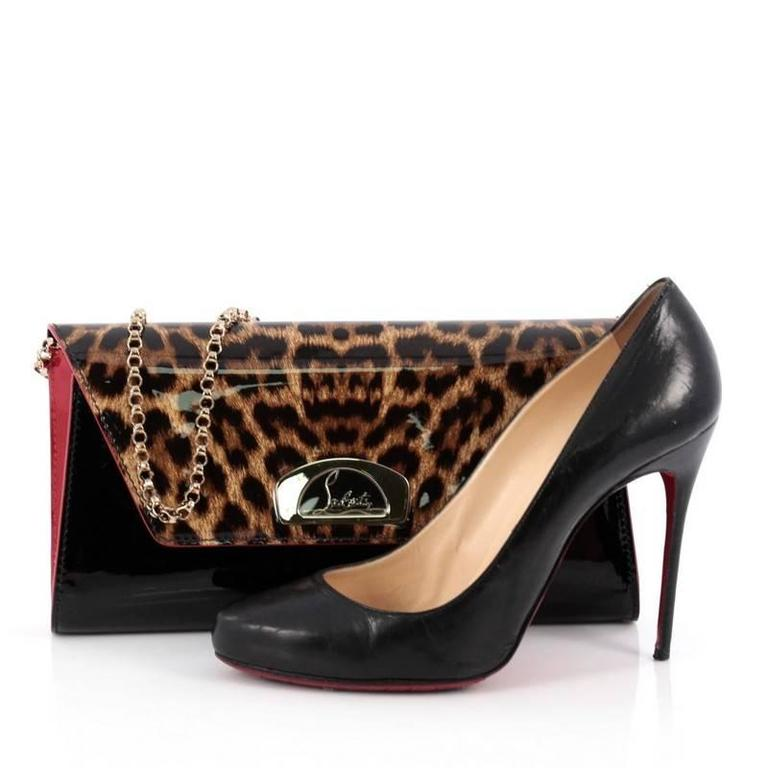 b88befb1fe This authentic Christian Louboutin Vero Dodat Clutch Patent, inspired by  the covered passageway that houses