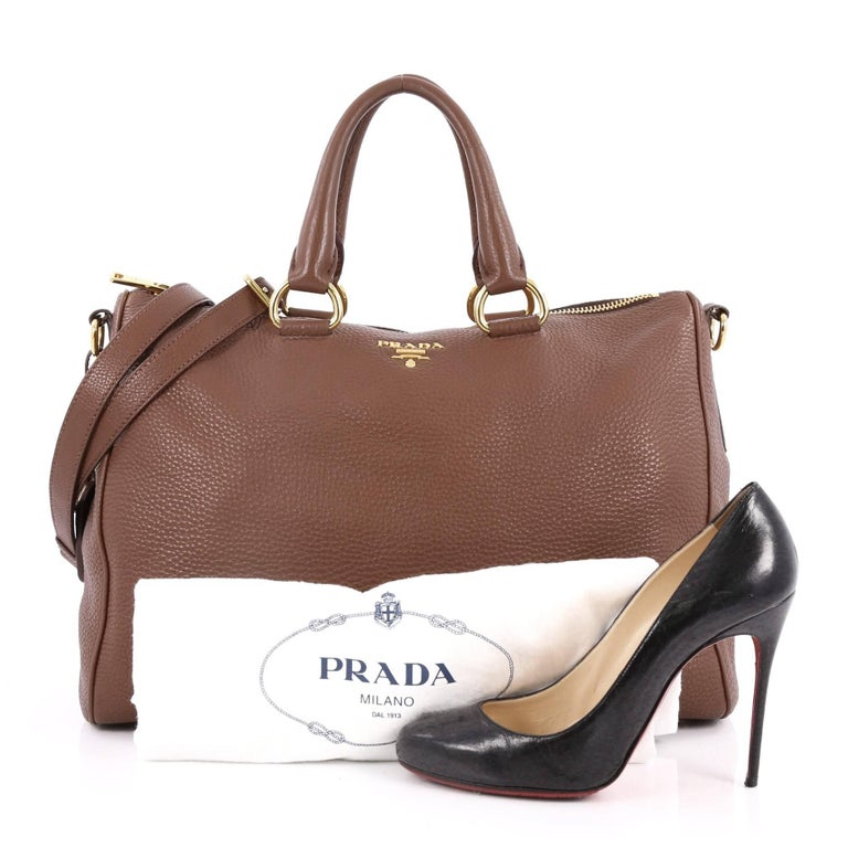 This authentic Prada Convertible Zip Satchel Vitello Daino Large is the perfect bag to complete any outfit. Crafted in brown leather, this satchel features dual-rolled leather handles, detachable strap, Prada logo at the center, protective base