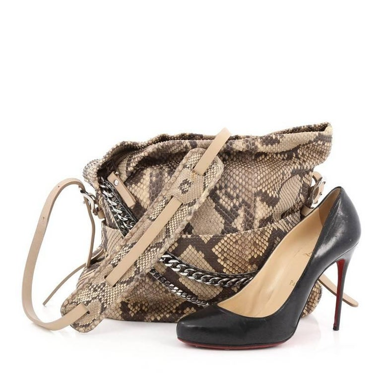 how to tell if it an authentic jimmy choo handbag