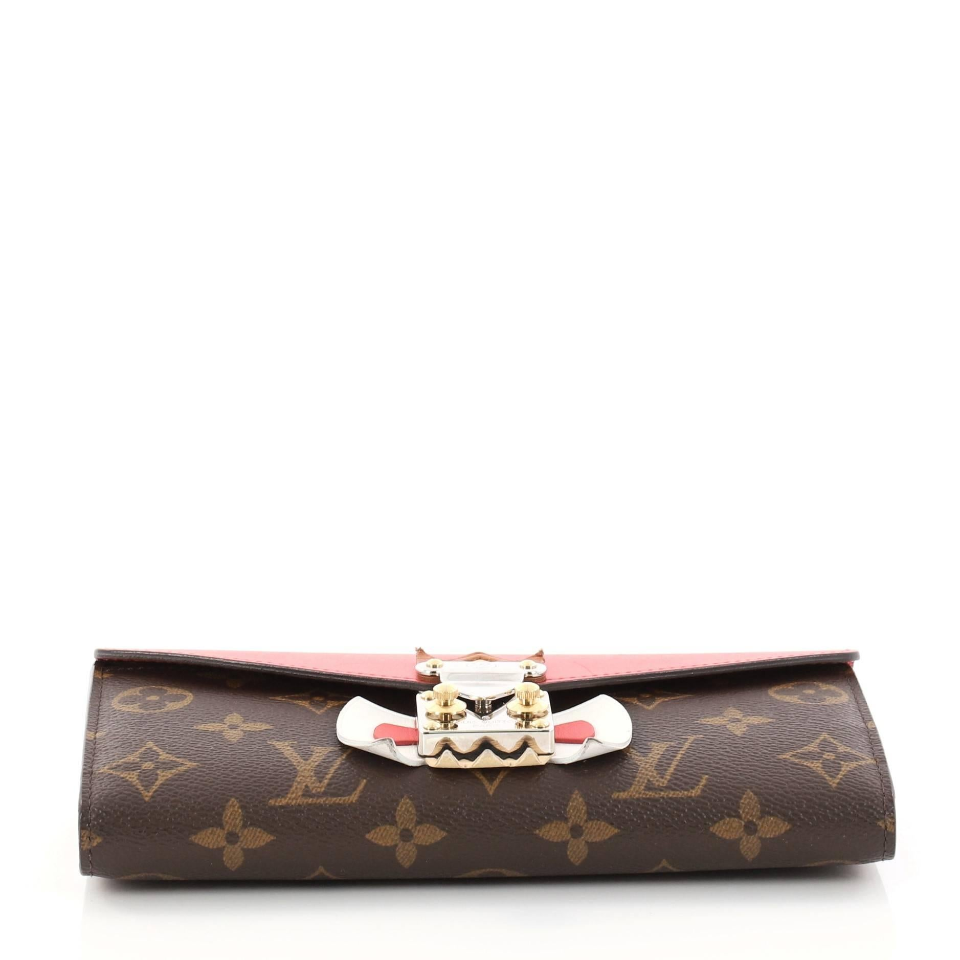 0be324fa82a Louis Vuitton Monogram Canvas and Leather Tribal Mask Sarah Wallet at  1stdibs