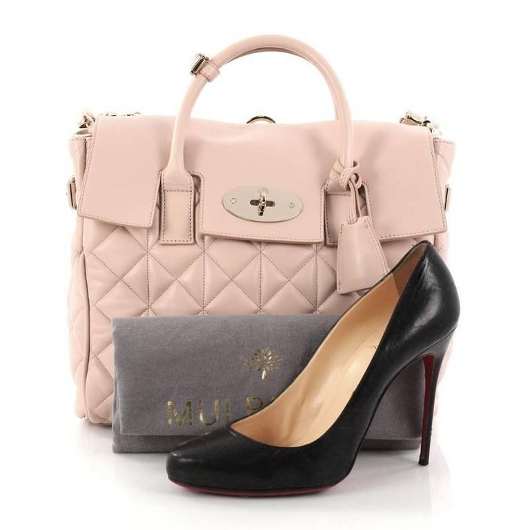 This authentic Mulberry Cara Delevingne Convertible Backpack Quilted Leather Medium is influenced by supermodel Cara Delevingne's cool practicality. Crafted in light pink leather, this clever and iconic handbag can be worn three ways: as a backpack,