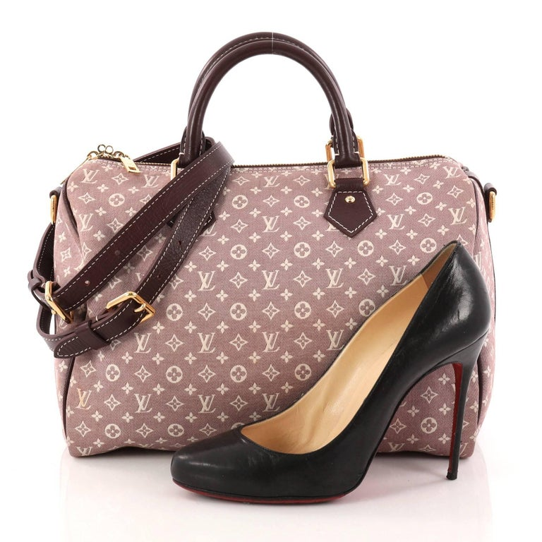 458da007774f This authentic Louis Vuitton Speedy Bandouliere Bag Monogram Idylle 30 is a  classic must-have