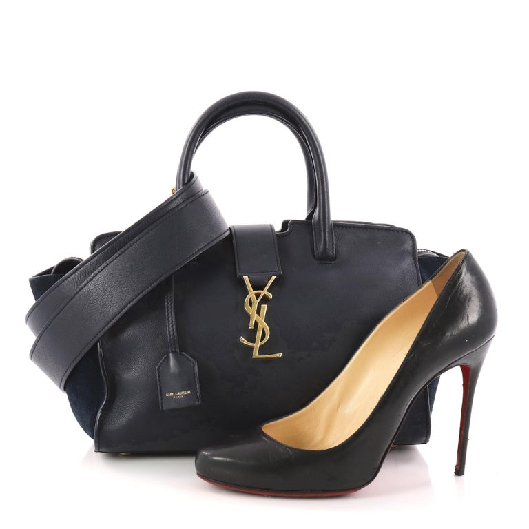 This authentic Saint Laurent Monogram Cabas Downtown Leather Baby combines  a modern and functional style with 94a47d4da7