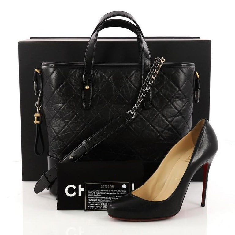 209ab4752af41c This authentic Chanel Gabrielle Shopping Tote Quilted Calfskin Medium  displays a luxurious design with timeless modernity