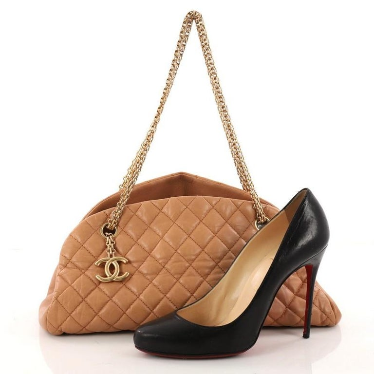 46597b7ae2bb1f This authentic Chanel Just Mademoiselle Handbag Quilted Aged Calfskin Medium  showcases a sleek style that complements