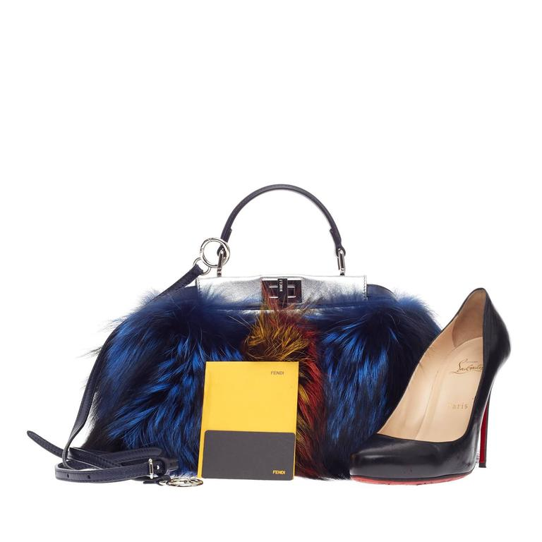 This authentic Fendi Limited Edition Peekaboo Fox Fur Mini presented in the brand's Spring/Summer 2014 Collection is a stunning, runway-ready piece made for the most daring of fashionistas. Crafted in multicolored fox fur in shades of blue, red, and