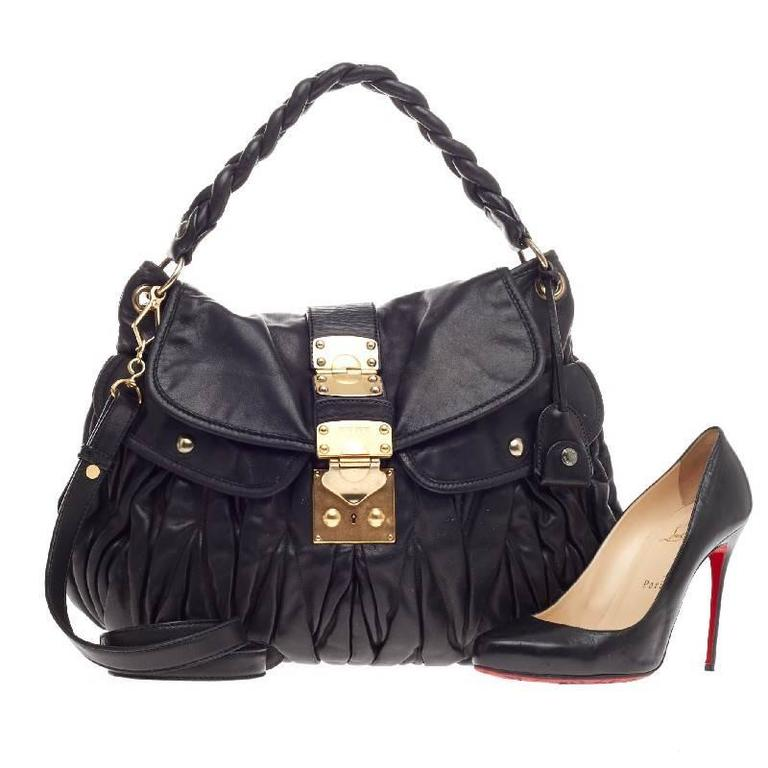This authentic Miu Miu Coffer Hobo Matelasse Leather is crafted in a  feminine ruched design that 5cfbe12fefbc6
