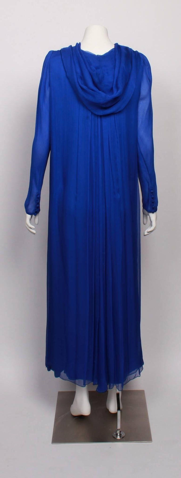 Amazing and rare YVES SAINT LAURENT 1970s Couture  Silk Chiffon Hooded Evening Gown.  Features YSL unique couture numbering on label.   Made from textured silk chiffon and fully lined in the famous and classic YSL statement colour  - majorelle