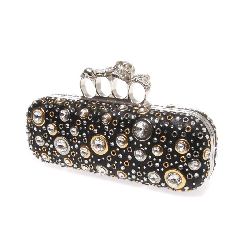 ALEXANDER MCQUEEN NAPPA LEATHER AND STUDS KNUCKLE BOX  A marvellous nappa leather and studs embellished knuckle box by ALEXANDER MCQUEEN. Intricately crafted with black nappa leather with all-over studs and Swarovski crystal detail rings Brass