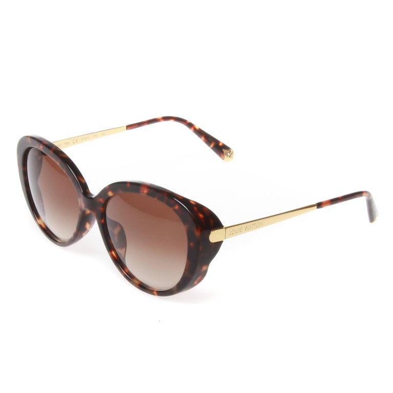 fed6ba6253 Louis Vuitton Bluebell Sunglasses in an exclusive dark tortoiseshell  acetate with goldtone accents. Beautifully rounded