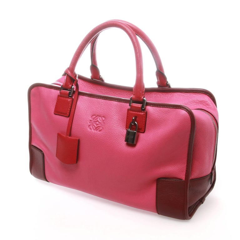 FINAL SALE Madam Virtue & Co  Loewe Amazona 36 bag in a rare pink tri-tone grained leather colourway. Features gunmetal-tone hardware, dual rolled handles, embossed logo embellishment at front face, tonal leather interior, dual pockets at interior
