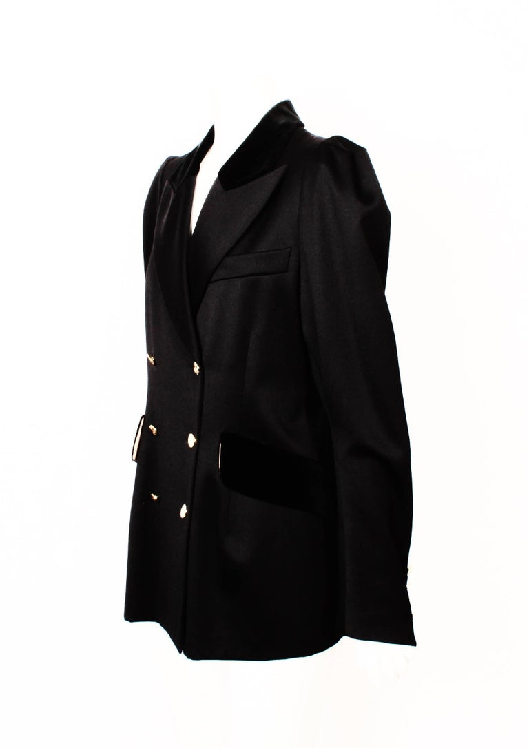VIVIENNE WESTWOOD double breasted tailored  jacket  . Features beautiful ornate gold Westwood logo buttons on front of jacket and cuffs. Jacket is wool gaberdine with velvet pocket flaps and top collar.  Care and composition label have been removed.