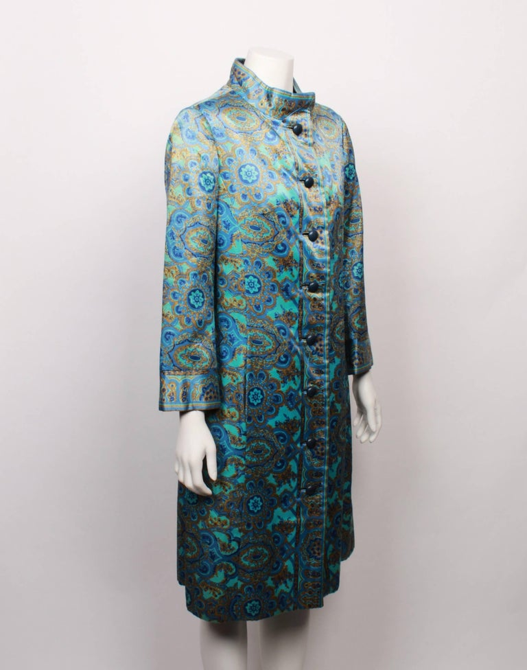 This stunning Christian Dior New York evening coat was made for Dior's American Market. Featuring a gorgeous stained glass-inspired floral and paisley print in shades of turquoise and gold on silk, it is the height of opulence. The rich fabric is