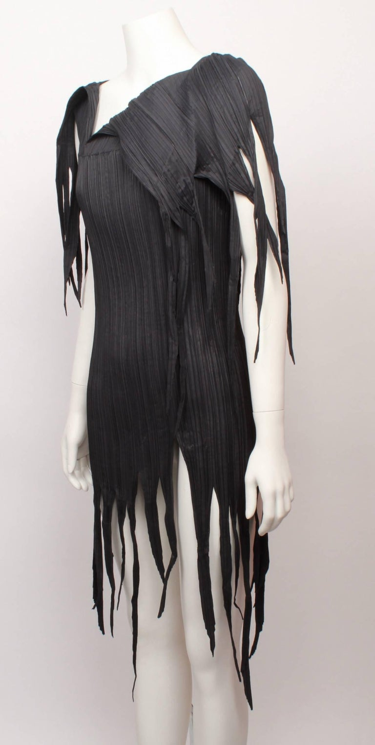 , Issey Miyake dark olive/grey long pleated top with jagged fringed  hemline and asymmetric neckline in iconic Issey Miyake pleats.  Fabric is stretchy and measurements are with garment flat and un-stretched.  Would fit small to medium.