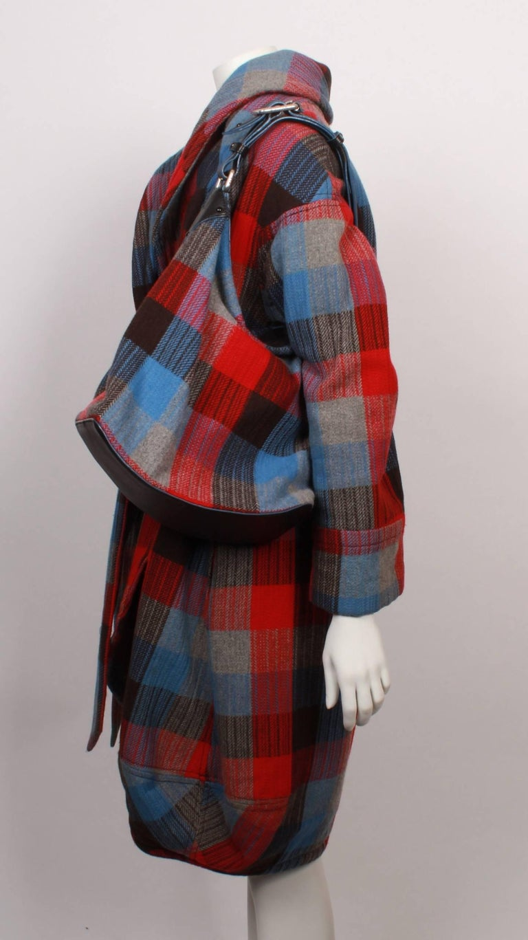 Marc Jacobs black, red, grey and blue checked wool flannel wrap coat & matching shoulder bag.  Coat has roll collar, bubble hemline and wide tie belt.  Bag measures 29cmH x 39cmW x 15cmD and features outside zip pocket, inside zip pocket and