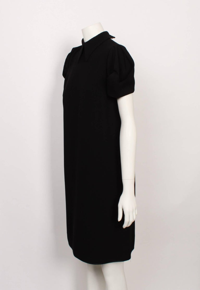 a4bddc39f705 Classic Miu Miu cool. Black shift dress with large peaked collar and short  puffed sleeves