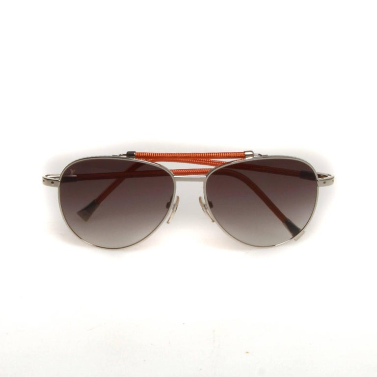 1828eeaf955 Silver-tone metallic Louis Vuitton Conspiration Pilote aviator sunglasses  with orange woven wire trim