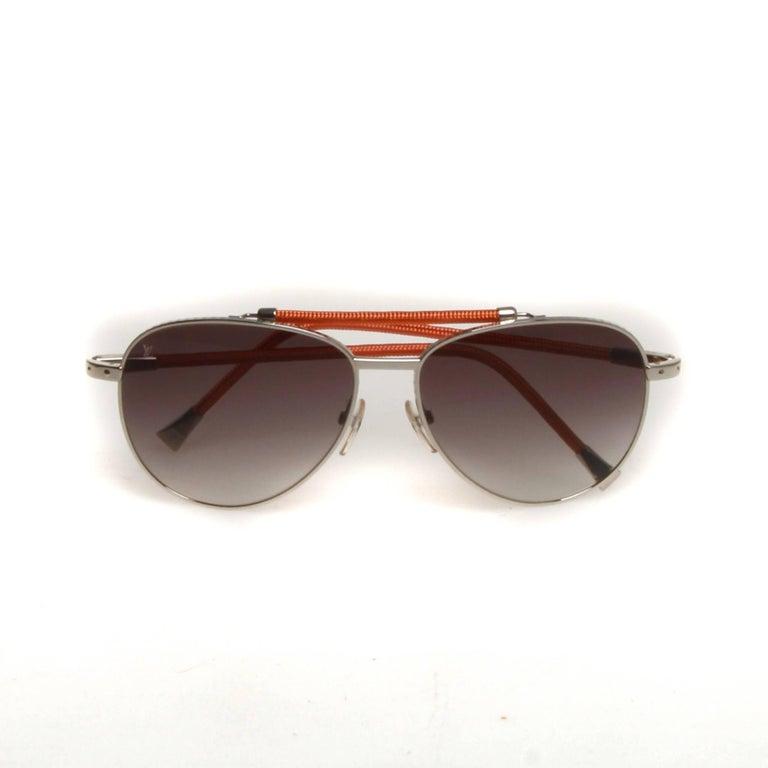 be73783fd5c0 Silver-tone metallic Louis Vuitton Conspiration Pilote aviator sunglasses  with orange woven wire trim