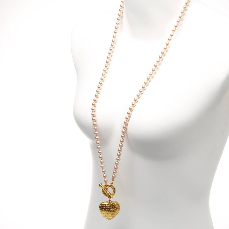 4a51aba856141 Givenchy pearl necklace with gold ring and heart pendant