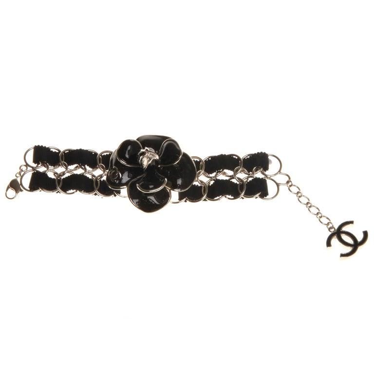 2ce52c57509 Chanel Black Enamel Camellia Bracelet For Sale at 1stdibs
