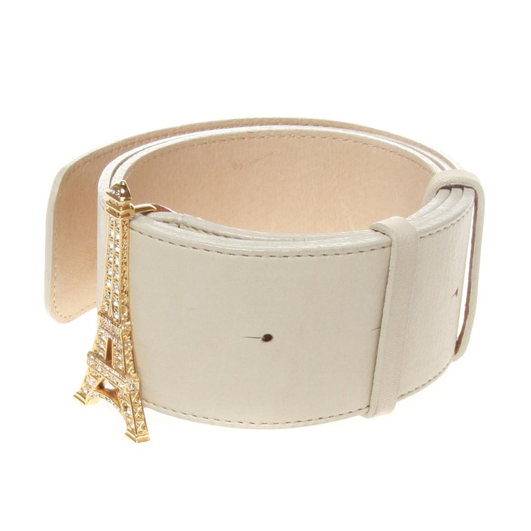 A beautiful 49Av. Junko Shimada Eiffel Tower gold buckle belt. The Paris themed buckle sparkles with embellished crystals set against a neutral nude leather strap.