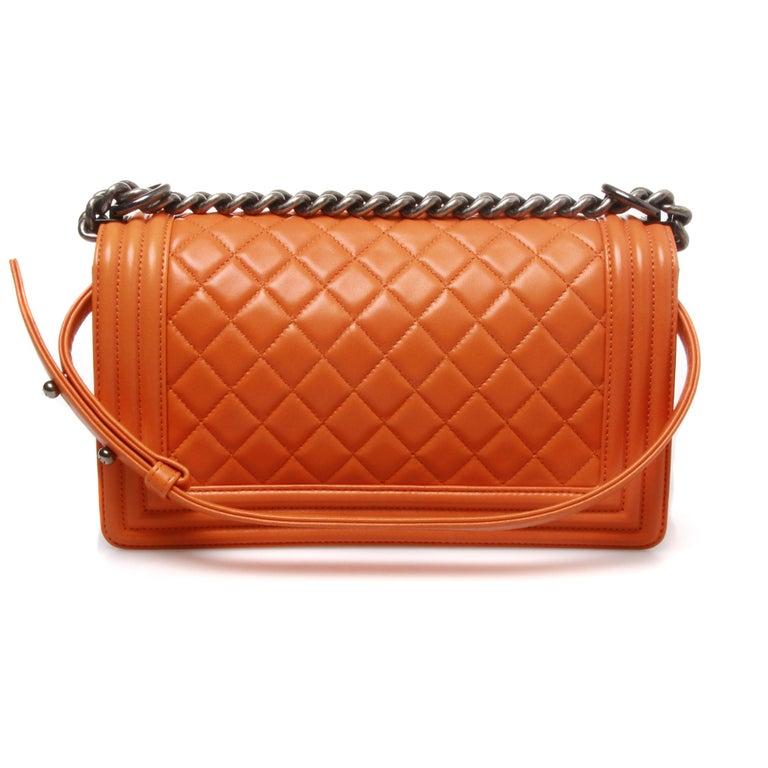 Orange Chanel medium lambskin quilted boy bag For Sale